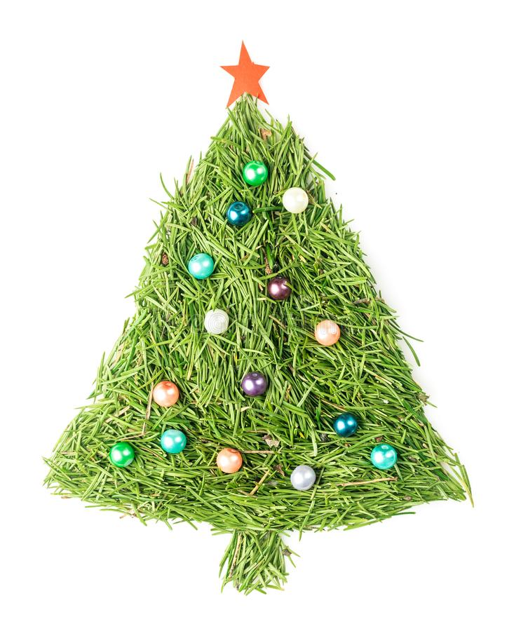 Christmas tree decorated. Christmas tree made of spruce needles decorated with beads and star on isolated white stock photo