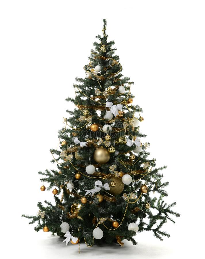 Christmas tree decorated with gold patchwork ornament artificial star hearts presents for new year 2019 isolated on white. Background royalty free stock image