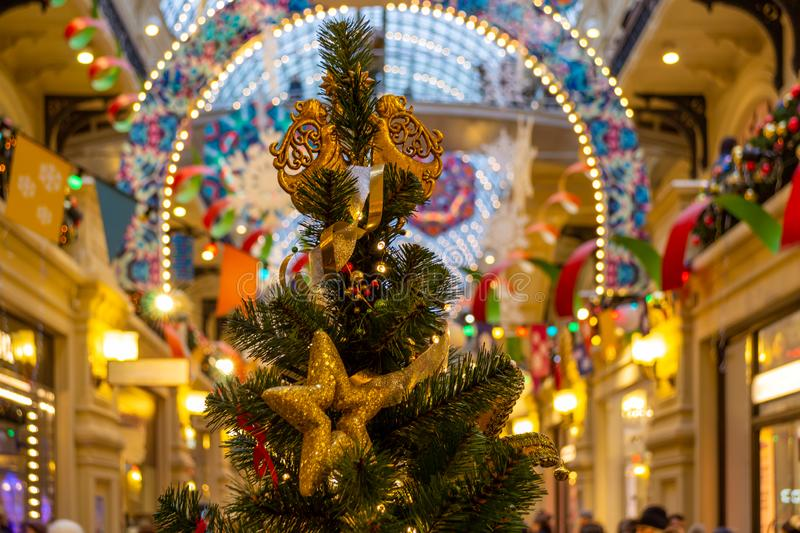 The Christmas tree is decorated with lights, toys, angels, stars, ribbons, cones royalty free stock photo