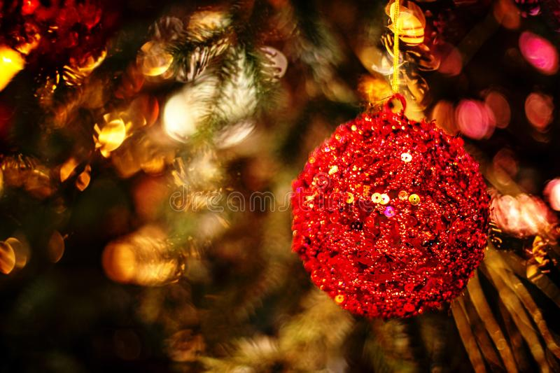 Christmas tree decorated with Red balls and ribbons  on a blurred abstract sparkling background. Xmas Festive Fairy Card royalty free stock photography