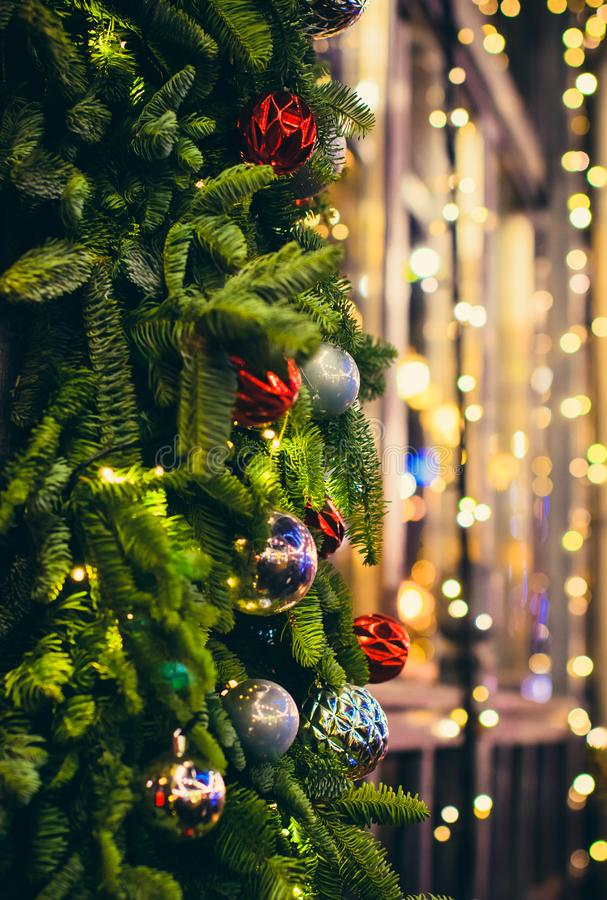 Christmas tree decorated with red and silver balls bokeh royalty free stock photos