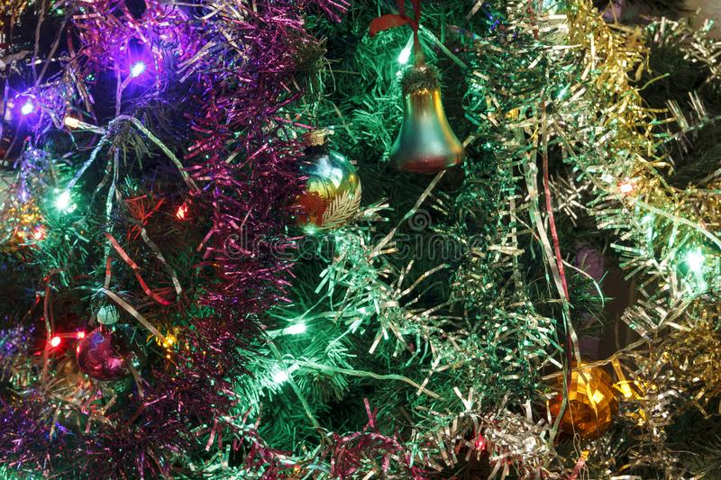 Christmas tree, decorated with toys and light bulbs. stock image