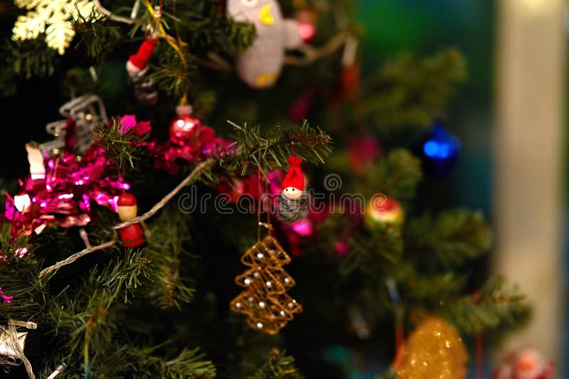 Christmas tree decorated by toys ,model,ornament royalty free stock images