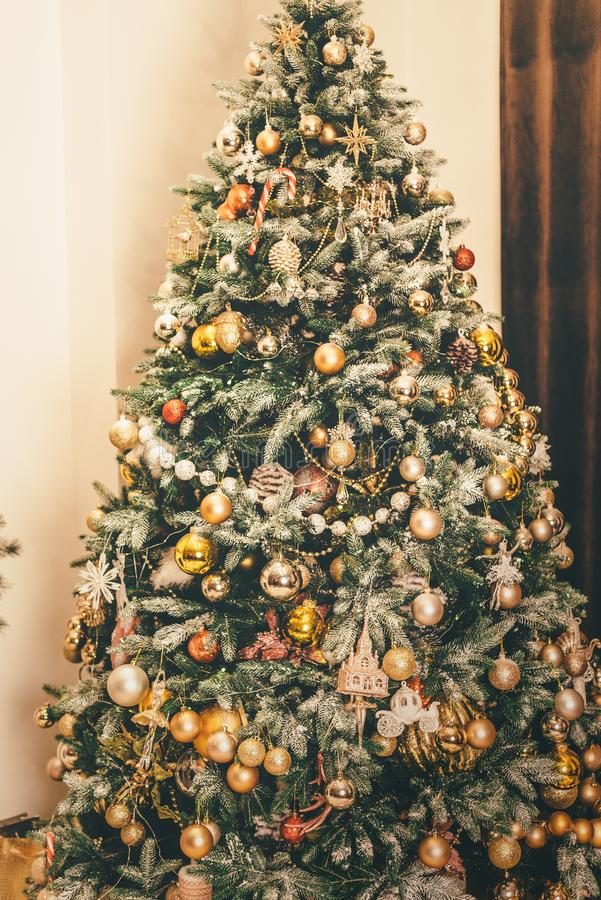 Christmas tree decorated in warm, cozy shades royalty free stock image