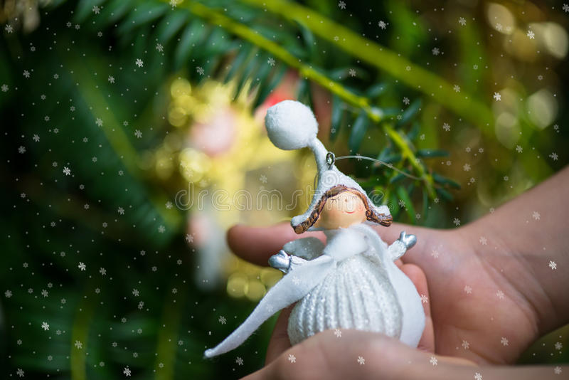 Christmas Tree Decoration Angel in Hands of Little Girl stock image