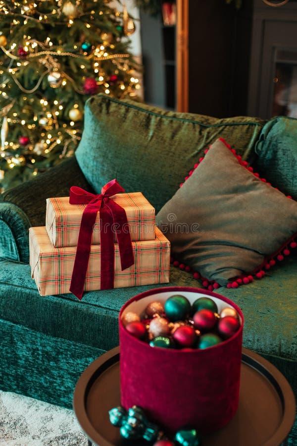 Christmas tree decoration ball velvet gift box. Christmas tree decoration ball velvet sofa and gift box in the interior, background, red, green, house, inside stock photo