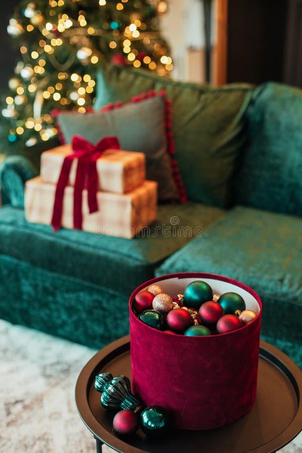 Christmas tree decoration ball velvet gift box. Christmas tree decoration ball velvet sofa and gift box in the interior, background, red, green, house, inside stock image