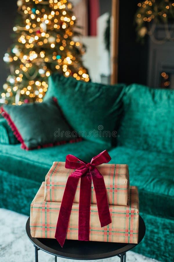 Christmas tree decoration ball velvet gift box. Christmas tree decoration ball velvet sofa and gift box in the interior, background, december, winter, shiny stock photos