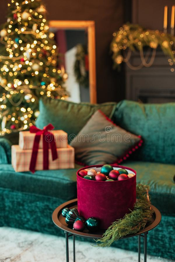 Christmas tree decoration ball velvet gift box. Christmas tree decoration ball velvet sofa and gift box in the interior, background, red, green, house, inside royalty free stock photos