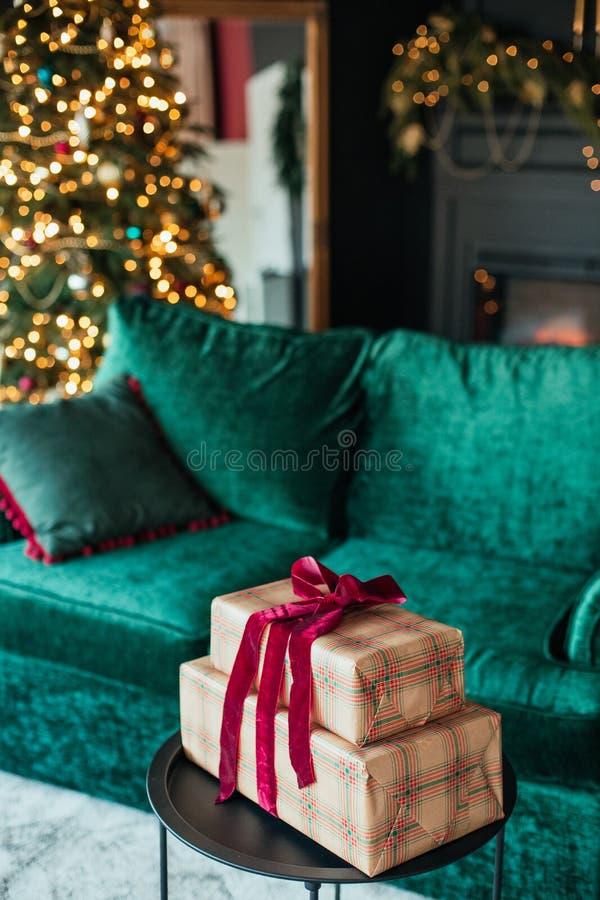 Christmas tree decoration ball velvet gift box. Christmas tree decoration ball velvet sofa and gift box in the interior, background, december, winter, shiny stock photo