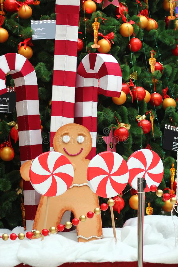 Christmas tree decoration, giant gingerbread man, candy canes and lollipops. Christmas tree decoration, giant gingerbread man and striped candy canes and stock photography
