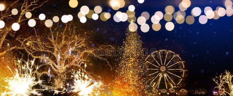 Christmas tree decoration and holidays lights on Christmas Season Market in Old city street stock photos