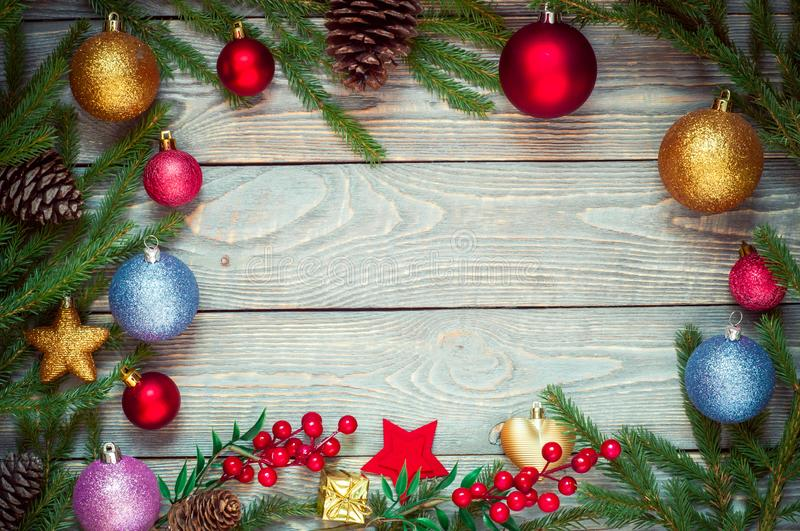 Christmas tree with decoration on a wooden Board. Christmas toy. New year. Free space for text.  stock photos