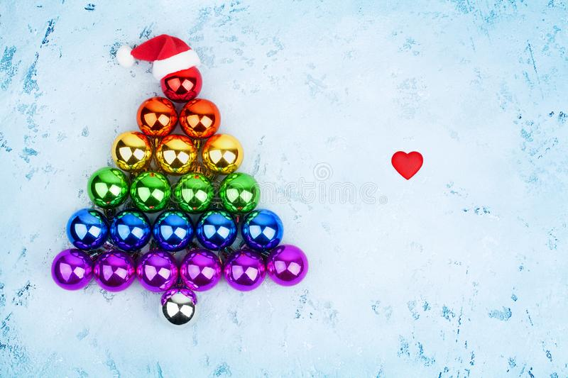 Christmas tree decorations balls LGBTQ community rainbow flag colors, Santa Claus hat, red heart, LGBT pride symbol, New Year stock photography