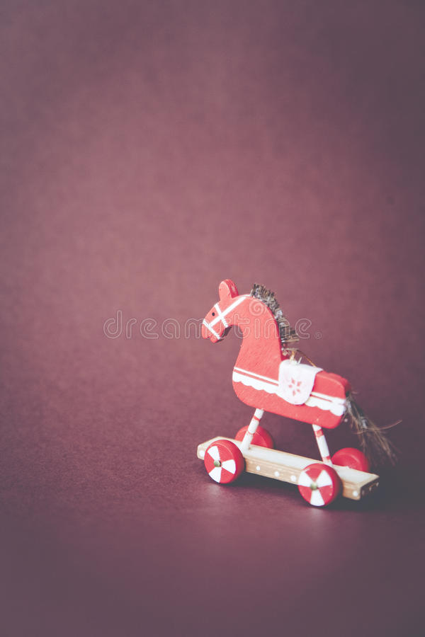 Christmas tree decorations. Christmasy horse christmas holly decoration royalty free stock image