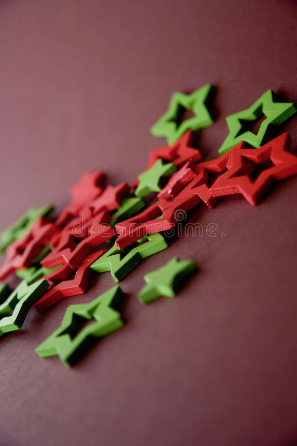 Christmas tree decorations. Christmasy red green star christmas holly decoration stock photography