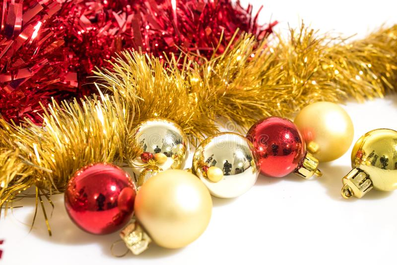 Christmas tree decorations, colorated red and gold balls isolate royalty free stock photo