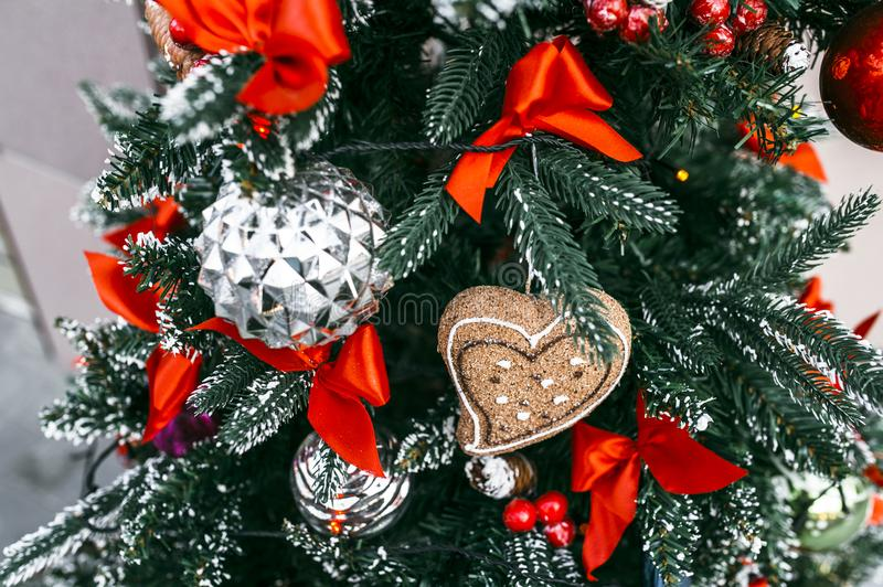 Christmas tree with toys. Christmas tree with decorations and a cupcake royalty free stock photos