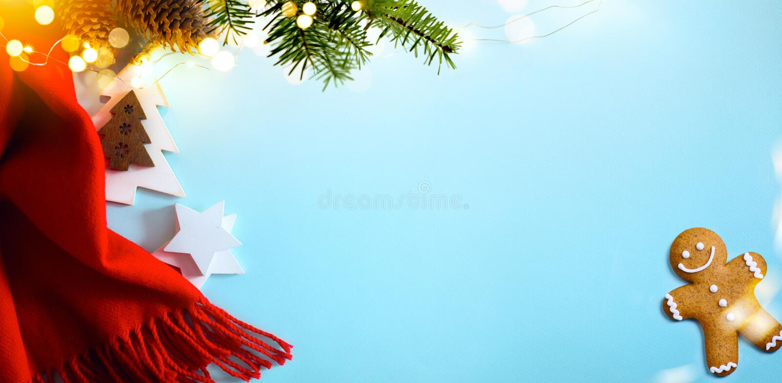 Art Christmas Tree with Decorations Light and Holiday Gift on Blue Background. New Year. Noel. Top view. Winter xmas Flat lay stock photos