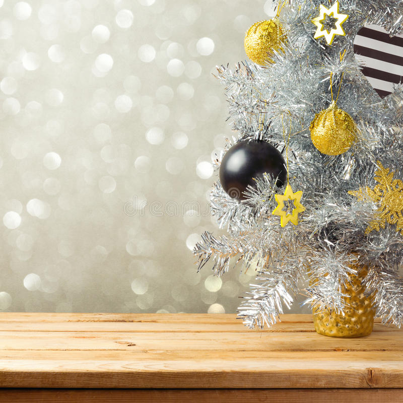Christmas tree and decorations over bokeh lights background. Black, golden and silver ornaments stock image