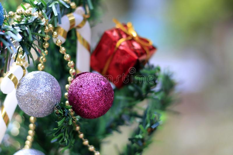 Christmas tree with decorations on a special background blur.  stock image