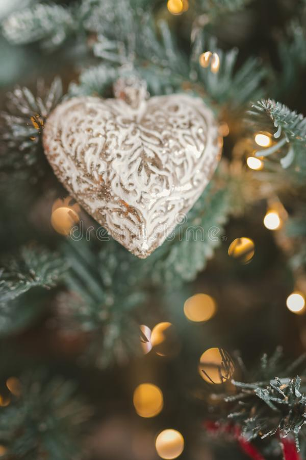 Christmas tree decorations. Toy in the shape of the heart and tinsel. Shallow depth of field. bokeh royalty free stock photography