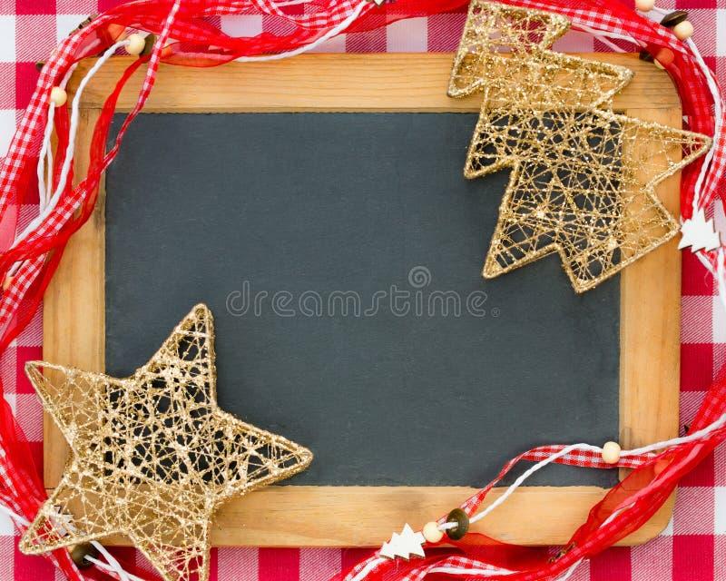 Christmas tree decorations on vintage wooden blackboard stock photo