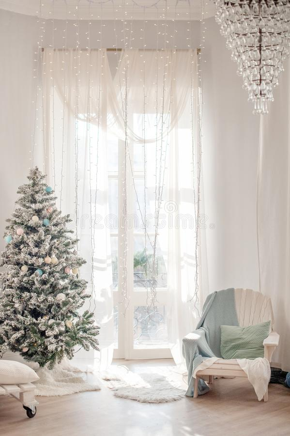Christmas tree with delicate decorations royalty free stock images