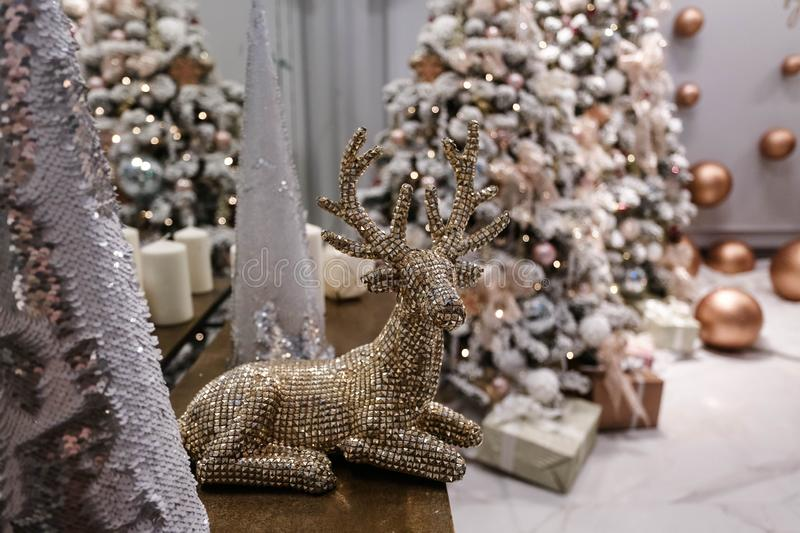 Christmas tree and details in decorated room royalty free stock photography