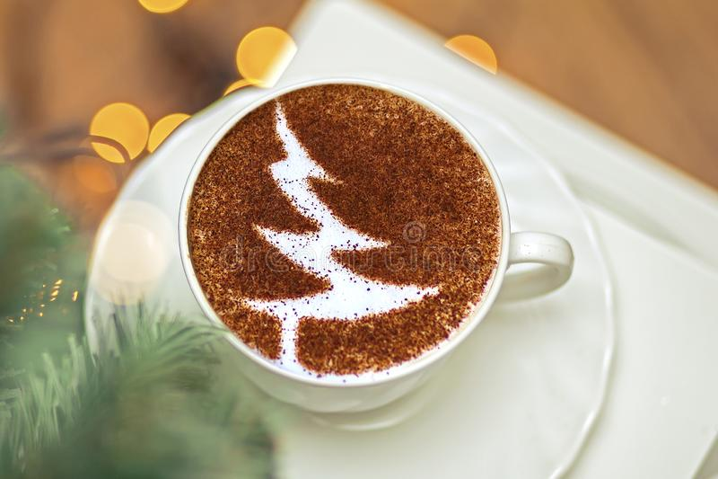 Christmas tree ,drawing coffee cup. Christmas tree ,drawing on latte art coffee cup stock image