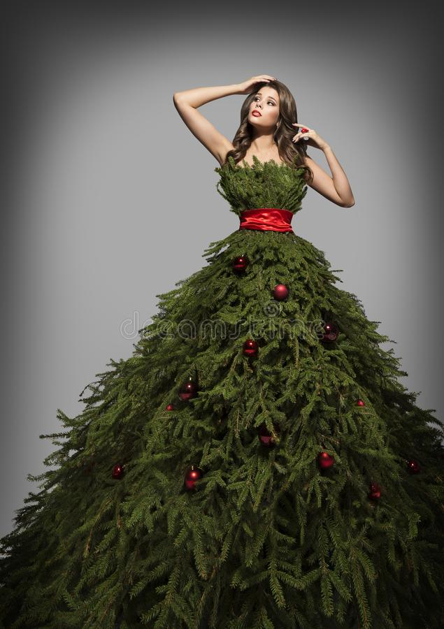 Christmas Tree Dress, Fashion Woman in Long Green Xmas Gown. New Year Studio Portrait stock images