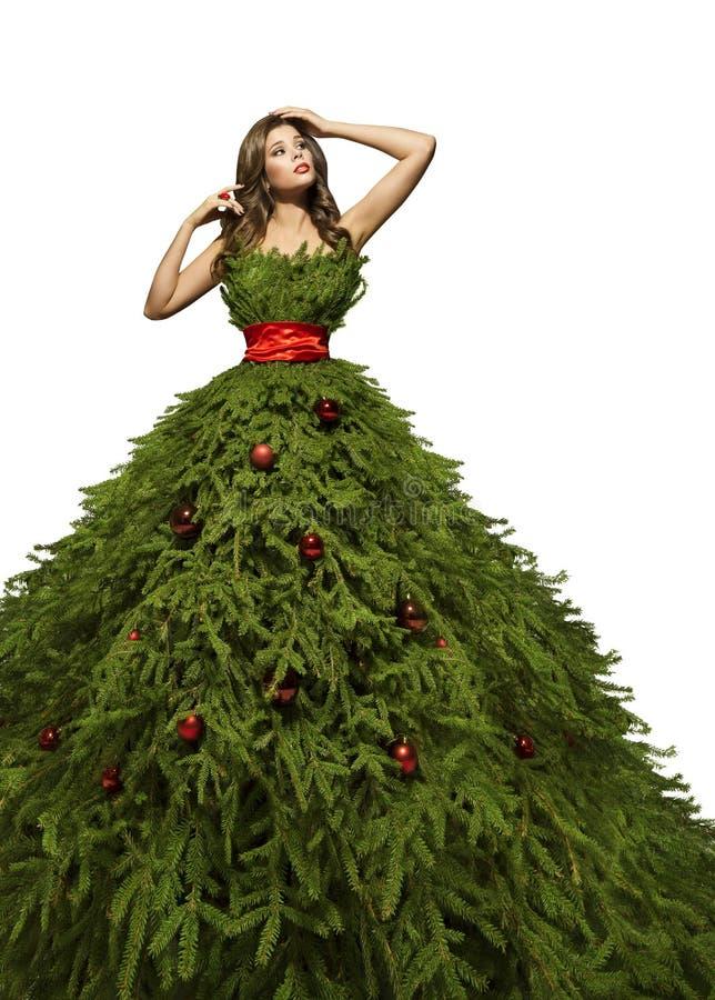 Christmas Tree Dress, Woman Posing Xmas Fashion Model Gown. Christmas Tree Dress, Woman Posing in Xmas Fashion Model Gown, New Year Girl Costume Isolated over stock images