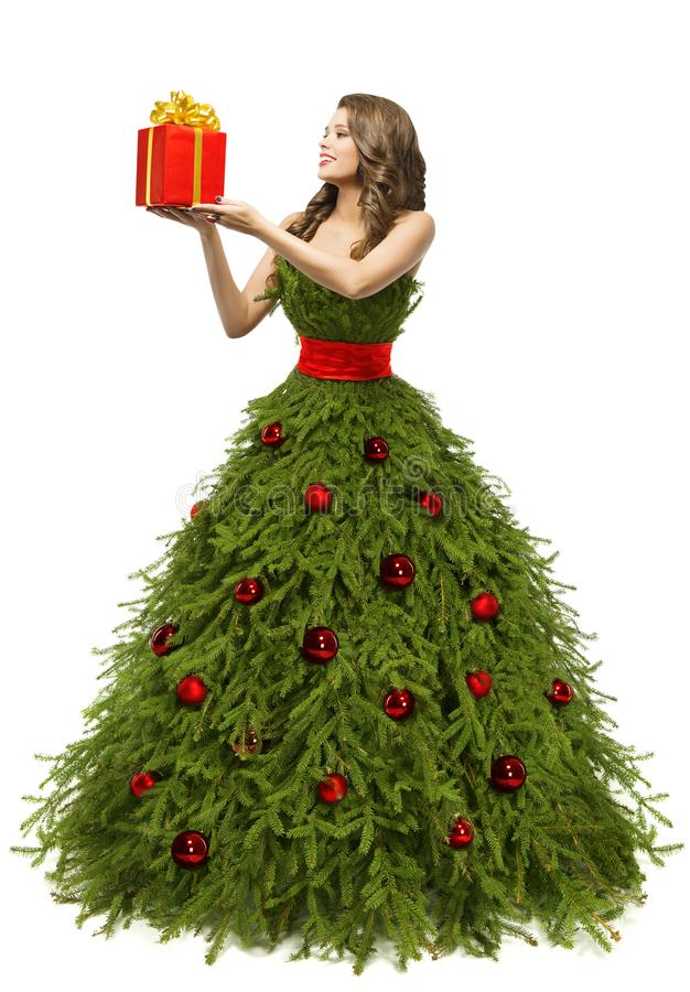 Christmas Tree Dress, Woman and Present Gift, New Year Fashion. Christmas Tree Dress, Woman holding Present Gift Box, Fashion Model in New Year Gown Isolated stock photography