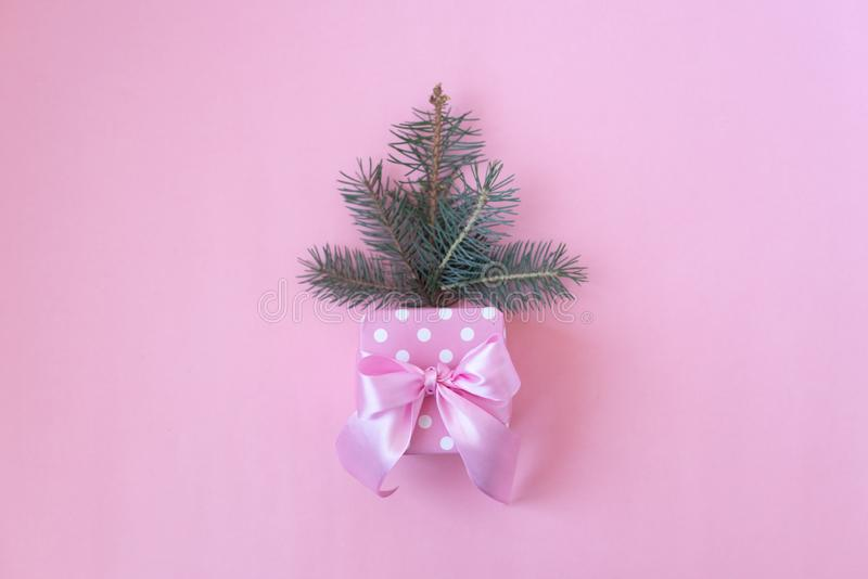 Christmas tree in envelope, minimal New Year s card. Spruce branch with pearls on pink background. Holidays, Congratulation royalty free stock images