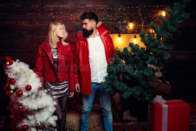 Christmas tree. Fashion couple over Christmas tree lights background. Having a crazy day with friend. Expression and. People concept royalty free stock images