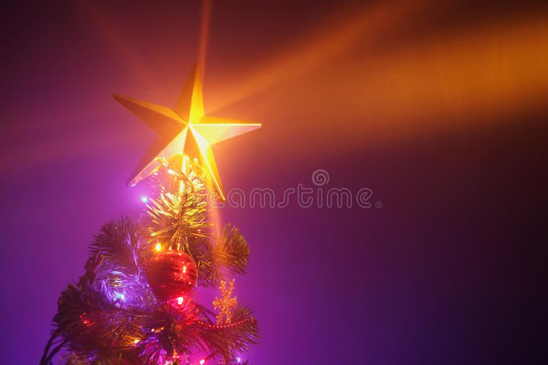 Christmas tree with festive lights, purple background stock images
