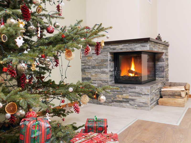 Christmas tree by the fireplace royalty free stock images