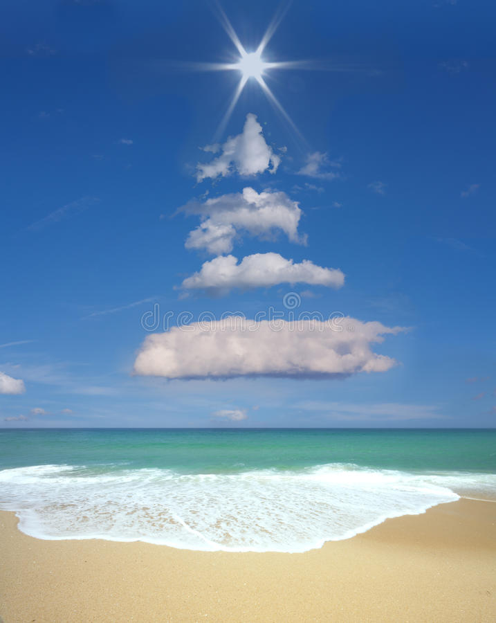 Christmas tree formed in the sky with clouds and sun. stock images