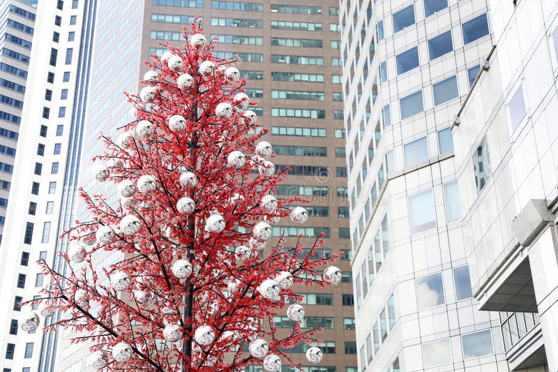Christmas tree in the front of modern buildings stock images