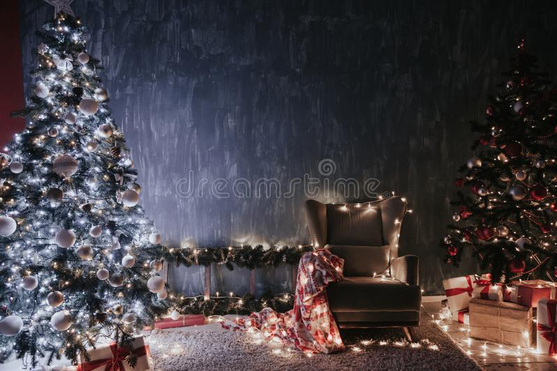 Christmas tree garland lights with gifts of new year holiday winter stock photo