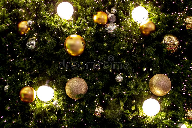 Christmas tree garland and ornaments. Hanging gold and red balls and ribbons. Christmas background. Happy New Year. Selective stock images