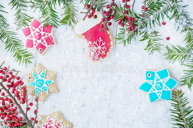 Christmas tree and gingerbread on a light background. New year celebration and christmas concept stock image