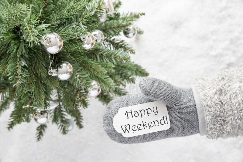 Christmas Tree, Glove, Text Happy Weekend. Glove With Label With English Text Happy Weekend. Green Christmas Tree With Silver Balls On Snow In Background stock photos