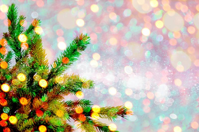 Christmas tree on the glow glitter background. Elegant abstract background with bokeh royalty free stock image