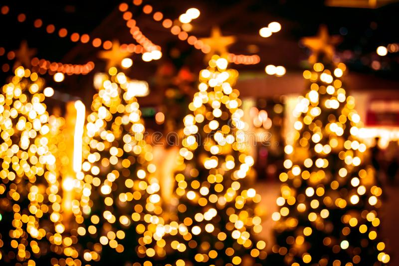 Christmas tree with gold bokeh light background. Xmas abstract b stock images