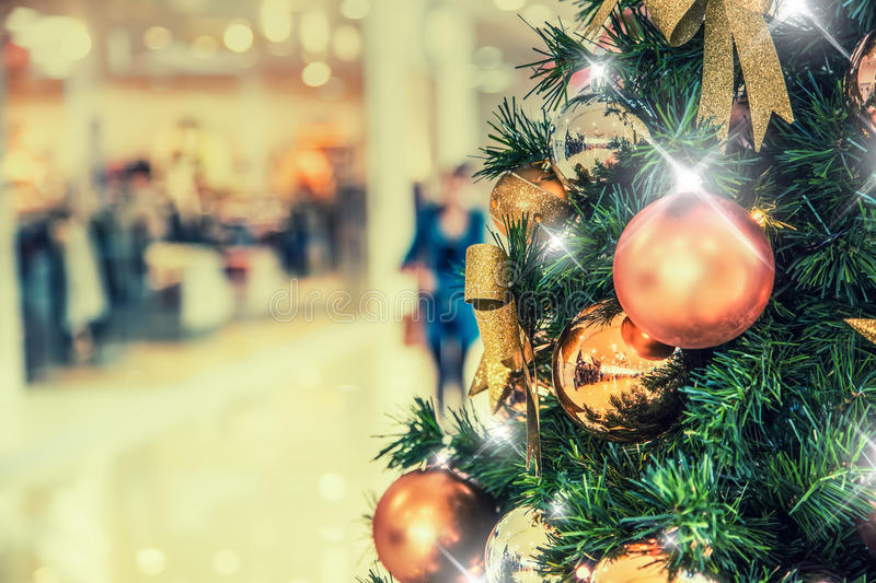 Christmas tree with gold decoration in shopping mall. Christmas clearance sales at the shopping mall. Elegant Christmas tree in a shopping mall stock images