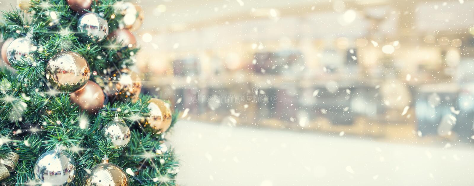 Christmas tree with gold decoration in shopping mall - panoramic. Blurred banner royalty free stock image