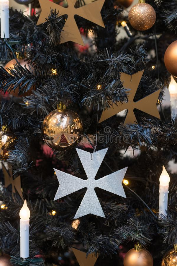 Christmas tree with gothic dark decor, golden balls, candles on dark in interiors. Xmas. Close up. Pattern royalty free stock images