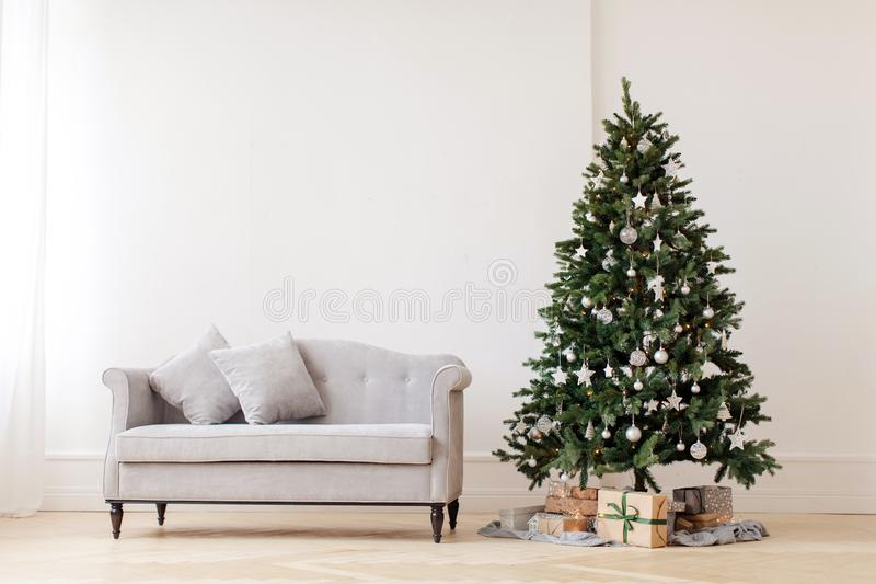 Christmas tree and gray couch royalty free stock images