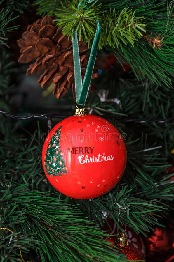 Free Christmas Tree Hanging Ornament, Red Globe With Write Merry Christmas, Close Up Stock Photos - 132730023